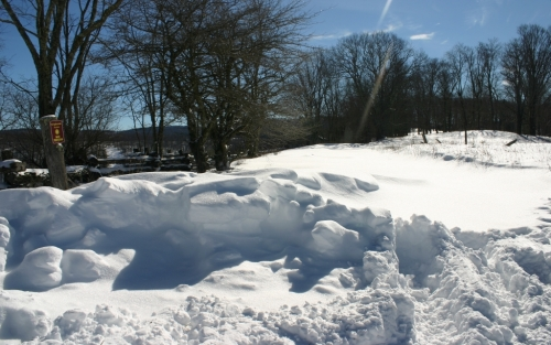 Snow drifts at the Brightside Acres gate.