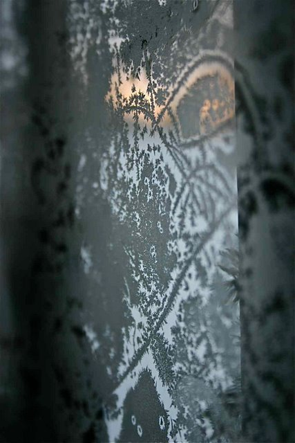 Ice crystals on the inside of storm door