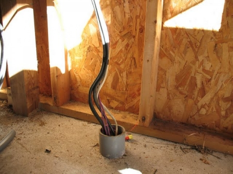 The starting point: all wires come up through an unfinished conduit that heads into the basement of the house where the house inverter and power system resides.