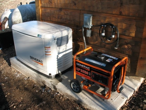 The complete generator set-up is shown. The automatic generator is to the left, the portable backup generator to the right.