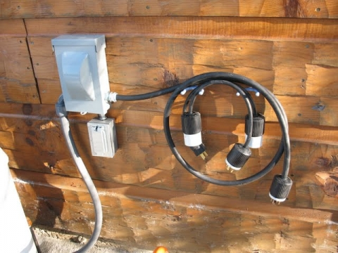 The main 30 amp cord and two adapter cords for 20 amp and 15 amp outlets from all makes of portable generators.